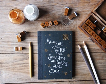 Pocket journal with Oscar Wilde quote in calligraphy, 4,15 x 5,70 inches We are all in the gutter