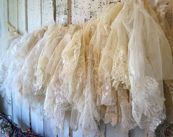White lace garland wall hanging French Nordic farmhouse tattered cream and ivory romantic shabby cottage chic home decor anita spero design