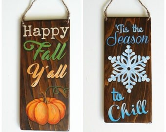 """Double sided wooden holiday/seasonal sign with """"Happy Fall Y'all"""" on one side and """"Tis the season to chill"""" on the other."""