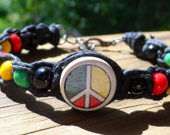 Black Hemp Bracelet with Rasta Colorded Beads and Ceramic Center Peace Sign
