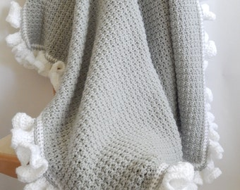 The Lauren Crocheted Blanket grey with white ruffle edging, baby crocheted blanket
