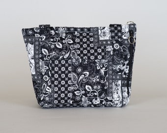 10 X 14,  top zipper closing,  6 pockets on inside and 4 outside, side pocket,  seperate from inside, for concealed storage, ipad,etc