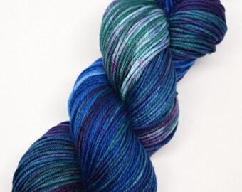 hand dyed yarn, hand painted yarn, handpainted yarn, superwash merino yarn, kettle dyed yarn, dk weight, blue purple green, moonglade, moon