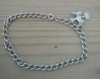 Vintage sterling silver charm bracelet with a bird with an envelope charm