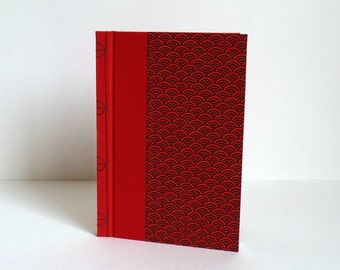 """Book drawing or guestbook. Japanese bookbinding, paper washi pattern """"seigaiha"""" red and black"""