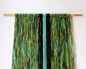 Yarn and braids wall hanging