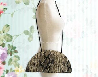 Vintage Zambos & Siega Half Moon Snakeskin pattern patent leather handbag.