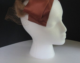 1950s vintage hat. Brown satin bow, fur cage with net. great for cosplay, prom, bridesmaids, or everyday!