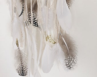 Macrame wall hanging with feathers