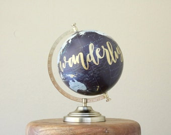 hand lettered calligraphy globe // wanderlust