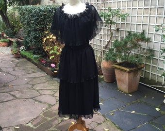 Vintage 1950's Alfred Werber 3 tiered black silk chiffon dress with a black silk belt. Size Medium/large.