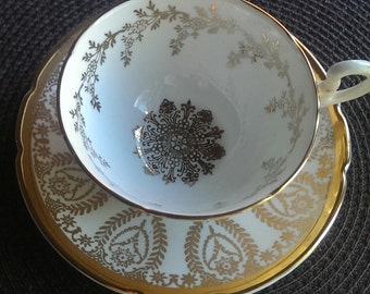 Stanley White and Gold Teacup