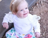 Girls angel wings bodysuit. Girls lace sleeve onesie. Baby girls flutter wings all in one. Lace sleeve bodysuit. Angel wings onesie.