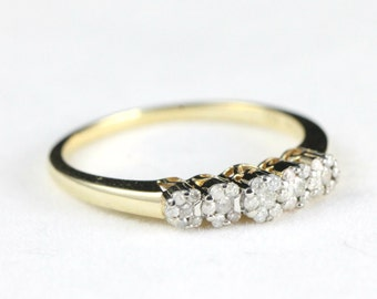 Floral diamond engagement ring in 9 carat gold for her