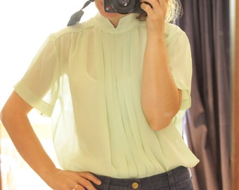 Sheer pleated pale green vintage blouse