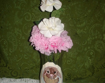 Rabbit vase with pink and white flowers