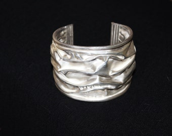 Winged Victory, folded silver cuff
