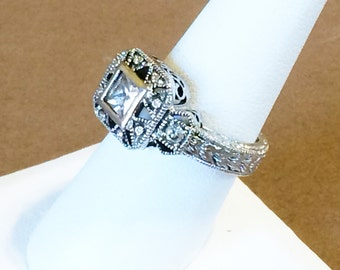 Size 8 Sterling Silver filigree And 1ct. Cubic Zirconia Ring