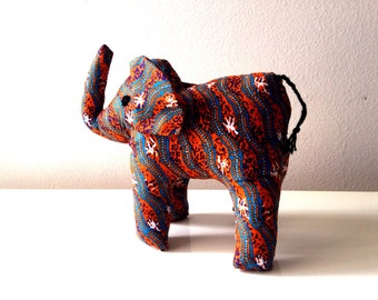 "Large african stuffed Elephant #011202 made by Ugandan Disabled Women. 10"" height and 8"" wide."