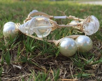 The double pearl bangle inspired by Bourbon and Bowties style