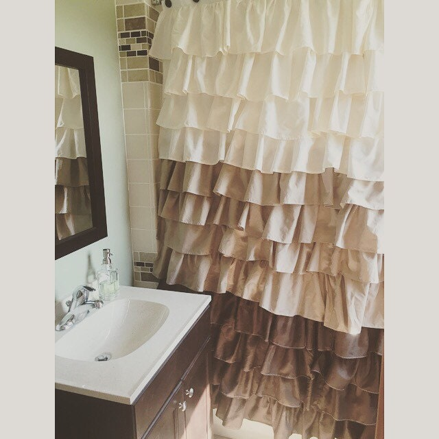 Interior Black Shower On Beige Tile Wall And Dark Brown Shower Curtains Added By White Choosing