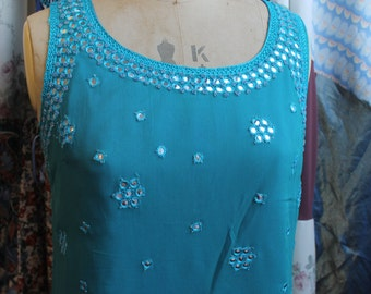 Sleeveless turquoise top with silver detail REF 206
