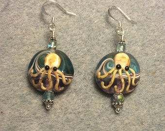 Light blue and tan lampwork octopus bead earrings adorned with light blue Czech glass beads.