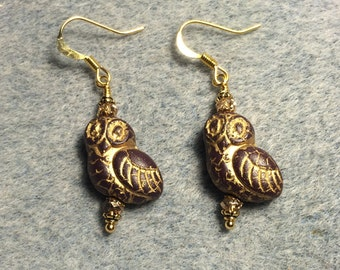 Brown with gold wash fancy owl bead earrings adorned with gold Chinese crystal beads.