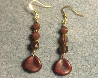 Opaque reddish brown Czech glass rose petal dangle earrings adorned with reddish brown Czech glass beads.