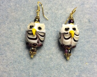 Purple and yellow lampwork owl bead earrings adorned with purple Czech glass beads