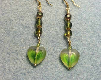 Olive green Czech glass heart bead dangle earrings adorned with olive green Czech glass beads.