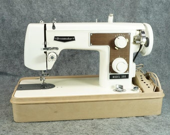 Dressmaker Model 300 Sewing Machine With Foot Pedal, Case And Bobbin