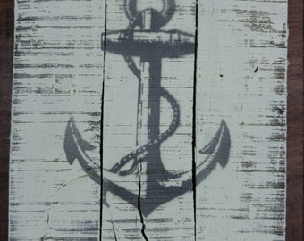 Pale yellow nautical anchor hand painted on aged wood