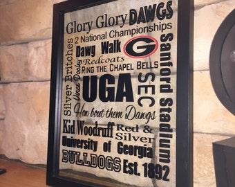 All things Georgia football. 11x14 wood frame on double pane glass.