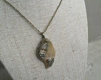 Steampunk Cogs set on stone pendant