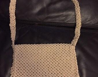 1980s hand crocheted string tasselled handbag