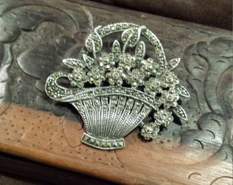 Sterling silver and marcasite basket with floral brooch