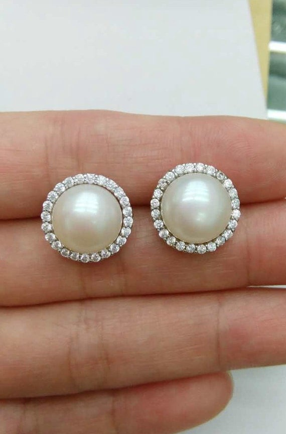 Large Pearl Earrings Stud, 16 mm ivory Pearl Earrings,Round Pearl Earrings,Faux Pearl Stud Earring, Light Pearl Earrings, men pearl earrings $ Free shipping Favorite Add to See similar items + More like this. Big pearl earrings freshwater pearl earrings,bridesmaid gift,mm large pearl earrings,wedding earrings,bridesmaid earrings.