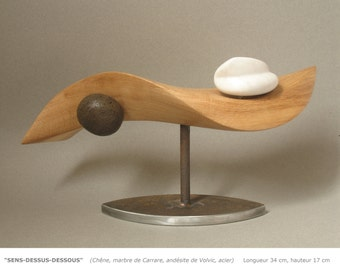 MEANING upside down carving wood, marble, steel