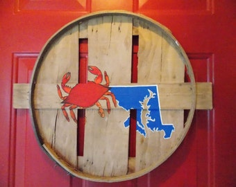 Maryland state outline w/ crab overlaying the panhandle. Hand painted on recycled crab bushel lid.