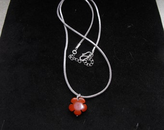 Red Jasper flower pendant on silver suedette cord necklace