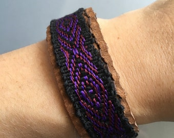 Friendship bracelet on brown leather. press stud closure