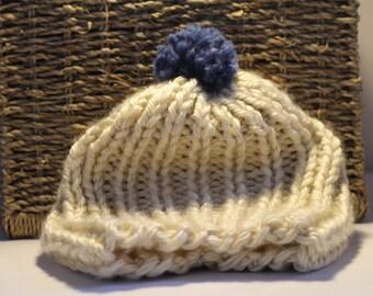 Hand knit beanie with pom pom