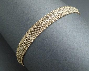Unusual soft 14 K gold bangle