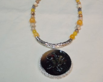 Hand made one of a kind Necklace  Carved shell flower
