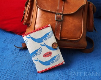 Paper passport cover: Blue whales.