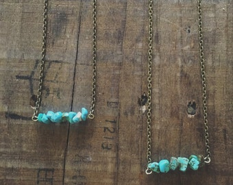 Short gold chain with turquoise stone bar