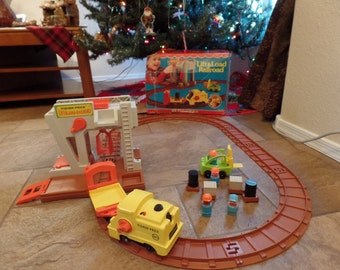 1978 Fisher Price Little People Lift and Load Railroad Set  100% complete with Train and Track and original box  # 943-Hard to Find! Clean!