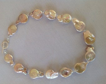 Blush Baroque freshwater coin pearls with sterling silver toggle clasp.