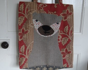Applique Otter tote bag handmade using a variety of recycled fabrics.